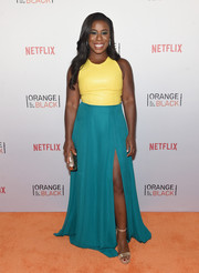 Uzo Aduba finished off her vibrant look with gold ankle-strap sandals by Tory Burch.