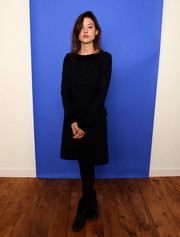 Astrid Berges Frisbey posed for her 'I Origins' portrait at Sundance sporting an all-black dress, tights, and boots combo.