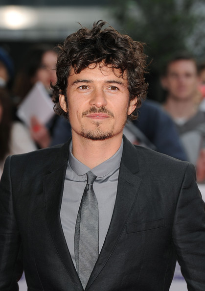 Orlando Bloom Narrow Solid Tie [hair,hairstyle,premiere,suit,forehead,white-collar worker,facial hair,beard,black hair,event,orlando bloom,national movie awards,london,england,royal festival hall,red carpet arrivals]