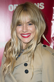 A deep blood red lipstick topped off Sienna Miller's classic and chic red carpet look.