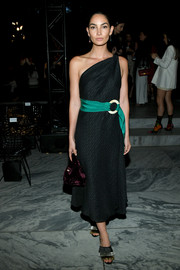 Lily Aldridge finished off her ensemble with a plum velvet purse by Hayward.