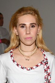 Zosia Mamet sported a casual brushed-back 'do at the Oscar de la Renta fashion show.