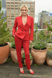 Yolanda Hadid looked smart in a red pantsuit at the Oscar de la Renta Spring 2019 show.