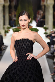 Bella Hadid rocked a cocktail ring on every finger when she walked the Oscar de la Renta fashion show.