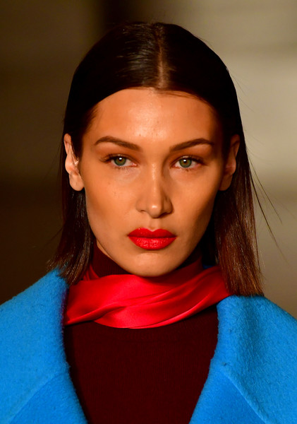 Bella Hadid's bright red lipstick worked beautifully with her colorful outfit.