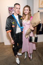 Frances Bean Cobain attended the Other Peoples Children launch carrying a two-tone bag with a gold chain strap.