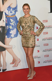 Cameron Diaz was all sparkly and sexy in a beaded gold mini dress by Emilio Pucci during the German premiere of 'The Other Woman.'