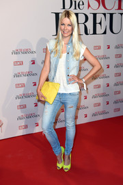 Tina Kaiser was rugged on the red carpet in a faded denim vest layered over a white tee during the German premiere of 'The Other Woman.'