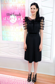 Jill Kargman complemented her LBD with a pair of scalloped cutout booties.