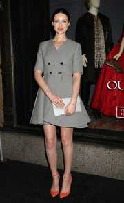 Caitriona Balfe donned a cute and classic double-breasted gray mini dress for the 'Outlander' and Saks Fifth Avenue photocall.