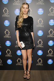Petra Nemcova sparkled in sequins with this black sleeved dress .