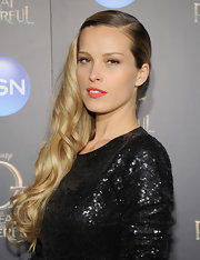 Petra Nemcova's red lips brightened up her glowing face and made her whole look pop.