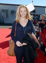 Lisa Kudrow was dressed down in a navy V-neck sweater and skinny jeans at the 2012 Express Yourself event.
