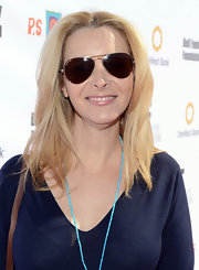 Lisa Kudrow attended the 2012 Express Yourself event wearing a straight layered hairstyle.