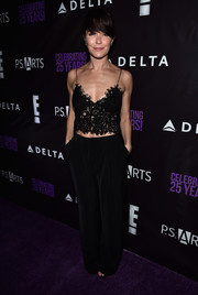 Katie Aselton opted for baggy black pants to finish off her look.
