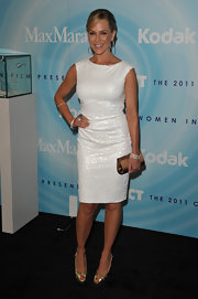 Julie Benz added shine to her sparkly white shift with gold knotted peep-toes.