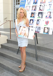 Pamela Anderson was on hand to support PETA in a pale blue draped drss with wooden platform sandals.