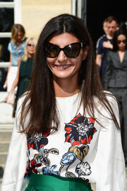 Giovanna Battaglia kept it simple with this long straight hairstyle at the Christian Dior fashion show.