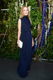 Natalia Vodianova looked chic and lovely in a navy jumpsuit with wide-leg pants during the Christian Dior fashion show.
