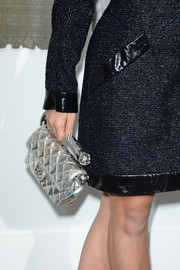 Rita Ora paired a tweed dress with a quilted silver purse, both by Chanel, during the label's fashion show.