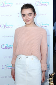 Maisie Williams was cozy and stylish in a blush-colored boatneck sweater while visiting the pre-Emmy luxury lounge.