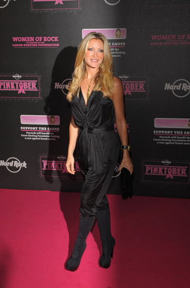 Caprice rocked a silky ruched jumpsuit tucked into black boots at a charity concert in London.