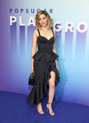 Alison Brie looked ultra feminine in a black corset dress with a ruffled peplum and hem at the Popsugar Play/Ground.