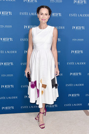 Minnie Driver completed her outfit with a pair of magenta satin sandals.