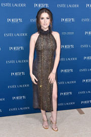 Anna Kendrick sealed off her chic look with strappy gold heels by Giuseppe Zanotti.