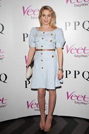 Puffed sleeves, gold buttons, and a flared hem gave Lydia Rose Bright's baby-blue shirtdress an ultra-feminine feel.