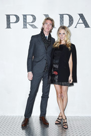 Poppy Delevingne attended the Prada Journal event looking smart in a black double-breasted blazer cape.