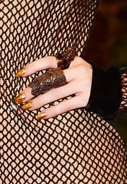 A super shiny gold nail gave Miley just an added touch of punk style at the 2013 Met Gala.