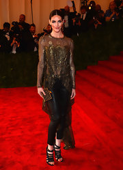 Hilary Rhoda kept the gold and black motif going with a grid-patterned box clutch by Kotur.