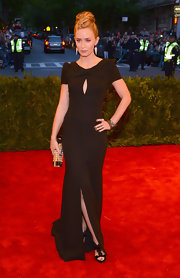 Emily Blunt stunned in a chic black gown that featured a pleated neckline and plunging back, which she wore to the 2013 Met Gala in NYC.