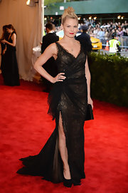 Jennifer Morrison's evening dress was a cool mix of punk and feminine with its flowing lace skirt and high leg slit.