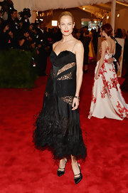 Carolyn Murphy went for the embellished look when she opted for this black frock that featured sheer lace panels at the bodice and a feathered hem on the skirt.