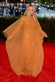 Ashley Olsen was golden orange from head to toe when she chose this long-sleeve, embellished dress that featured a sheer overlay.