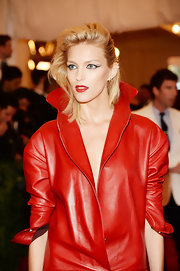 Anja Rubik rocked a shoulder-length teased 'do, which gave her blonde locks height and volume.