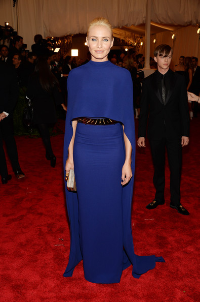 Cameron Diaz's sleek purple cape-gown had a bit of a Gothic touch to it with its flowing cape and studded belt.
