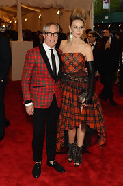 Tommy Hilfiger chose a red plaid blazer with a shawl-collar for his red carpet look at the Met Gala.
