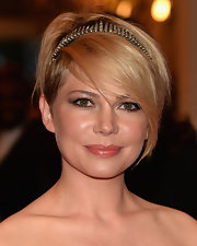 Michelle Williams showed off her grown-out pixie cut with a jeweled headband that showed off her side-parted bangs.