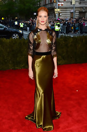 Rosie Huntington-Whiteley looked elegant and sophisticated in this black and gold gown that featured a netted top embroidered with sequins and a satin skirt.