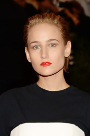 To counter balance her barely-there eyeshadow, Leelee opted for a bright red lip color.