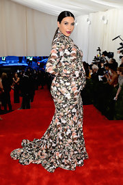 Kim Kardashian chose this floral-print gown that featured a high neckline, built in gloves, and a flowing skirt.