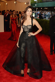 Nina Dobrev rocked this punk-inspired dress that featured a corset jumpsuit underneath and a sheer full skirt overlay.