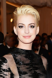 Anne Hathaway chose a nude lip to complement her fair skin and platinum locks at the Met Gala.
