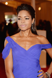 Naomie added a punk touch to her red carpet look with a teased half up, half down 'do.