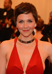 A basic red lip brightened up Maggie Gyllenhaal's beauty look at the Met Gala.