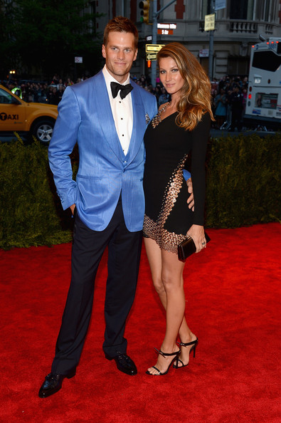Tom Brady chose a tux with a powder blue shawl-collar jacket and dark black pants for his red carpet look at the 2013 Met Gala.