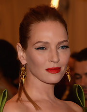 Uma Thurman chose a classic red lip for the 2013 Met Gala.